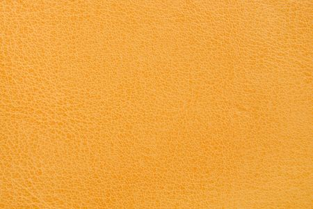 Natural yellow leather background closeup photo