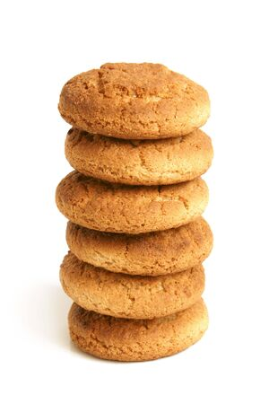 baked treat: Stack of oatmeal cookies on the white background Stock Photo