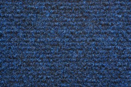 A blue carpet texture, close-up photo