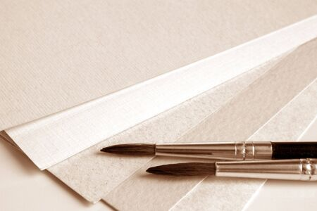 sable: Paint brushes on papers background, a horizontal picture  Stock Photo