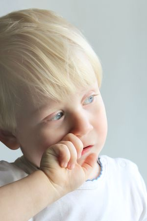 Little boy looking out the window photo