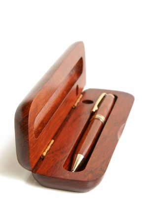 mahogany: Mahogany ball pen in an opened wooden case on a white background Stock Photo