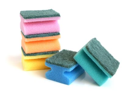 wash dishes: Multicolored sponges on a white background