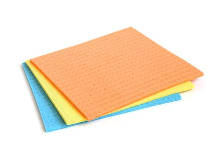 Multicolored sponges on a white background photo