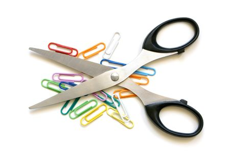 Scissors and multicolored paper clips on a white background photo
