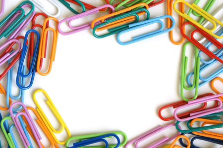 Multicolored paper clips on a white background photo