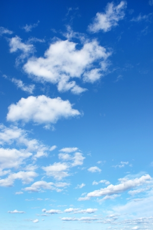 Blue sky with clouds, for backgrounds or textures photo