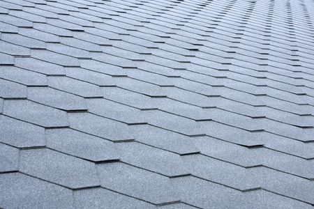 Gray tile roof, for backgrounds or textures photo