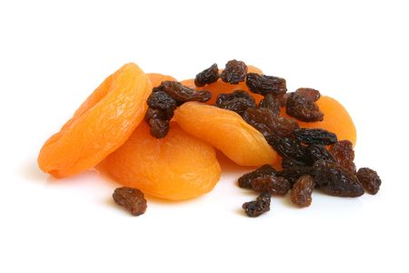 Dried apricots and raisins on a white background photo