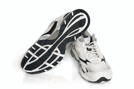 the sole of the shoe: Sport shoes pair on a white background