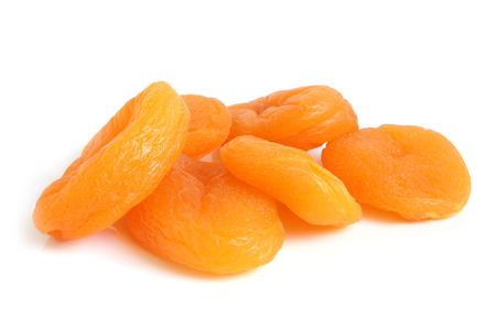 dried fruit: Dried apricots on a white background