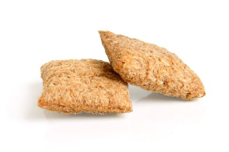 Pair of corn cookies on a white background photo