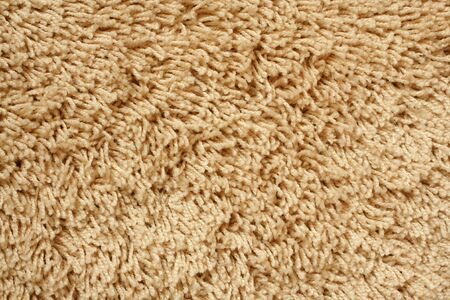 floor covering: A beige carpet texture, close-up
