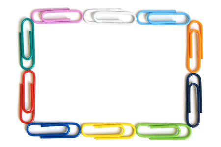 Multicolored paper clips on a white background Stock Photo