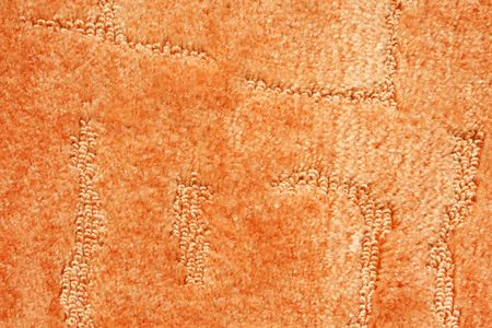 A orange carpet texture, close-up photo