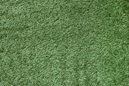 A green carpet texture, close-up photo