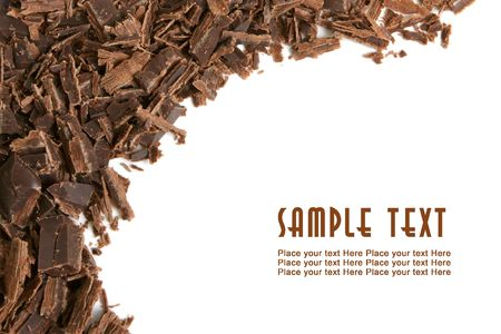 Dark chocolate shavings on a white background photo