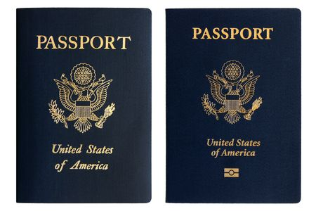 Old and new American passports isolated on a white background photo