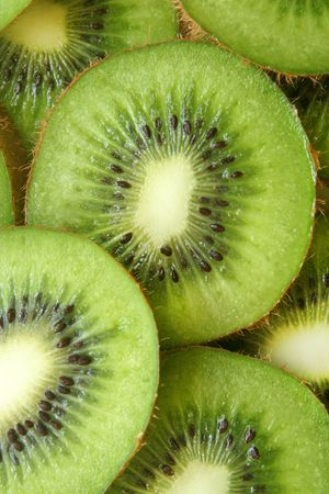 Kiwi fruit slices, for backgrounds or textures photo