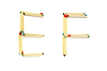 Letters E and F made of matches on a white background photo