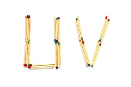Letters U and V made of matches on a white background photo