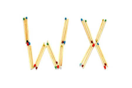 Letters W and X made of matches photo