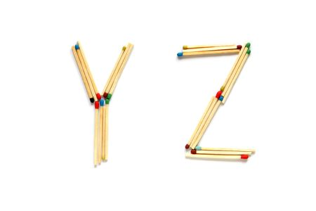 Letters Y and Z made of matches on a white background photo