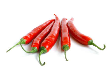 Red chili peppers on a white background photo