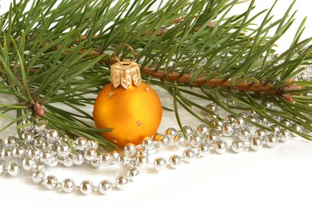 Christmas ball and green spruce branch on a white background photo