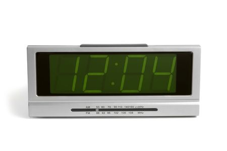 Digital electronic clock from radio on a white background photo