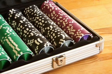 A set of casino chips on a wooden table photo