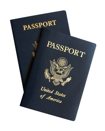 passport background: American passports isolated on a white background Stock Photo