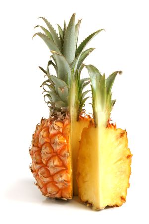 Ripe pineapple on white background photo