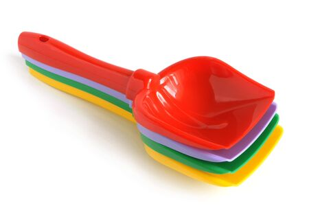 Colorful shovels on a white background photo