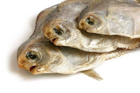 Dried piranhas on white background photo