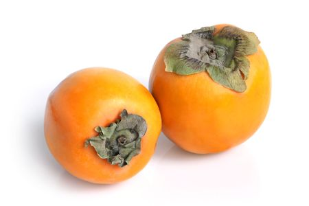 Two persimmons on a white background Stock Photo - 8259426