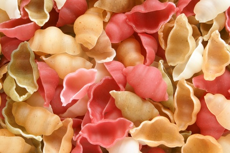 Close-up of italian pasta - colored seashells, for backgrounds or textures photo