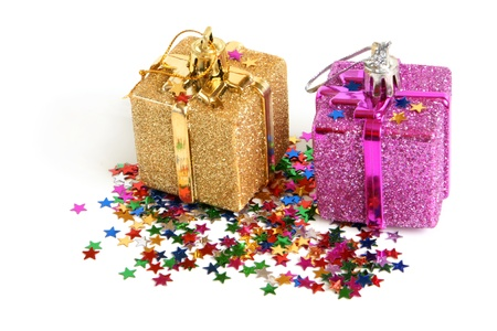 Two christmas toys with confetti on a white background photo