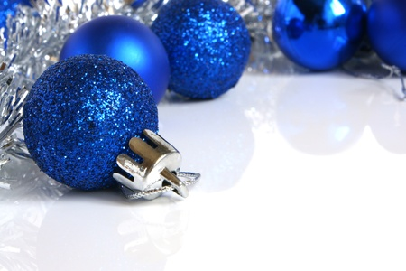 Blue christmas balls on a white background Stock Photo - 8325279