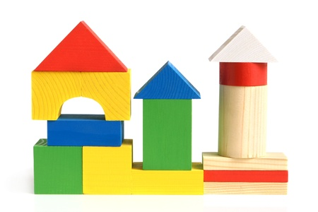 wooden blocks: House made from childrens wooden building blocks on a white background Stock Photo