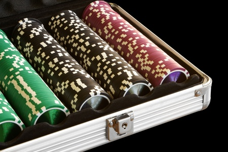 A set of casino chips on a black background Stock Photo - 8437976