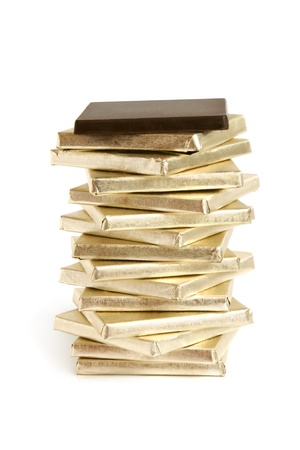 wrapped up: Stack of chocolate pieces on a white background