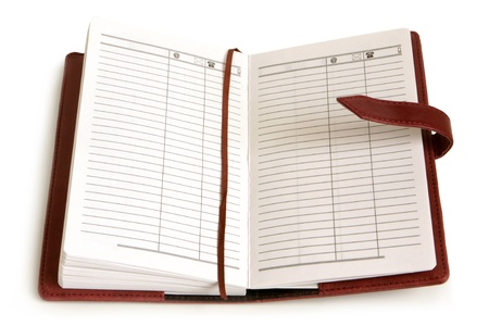 schedule reports: Leather personal organizer on a white background