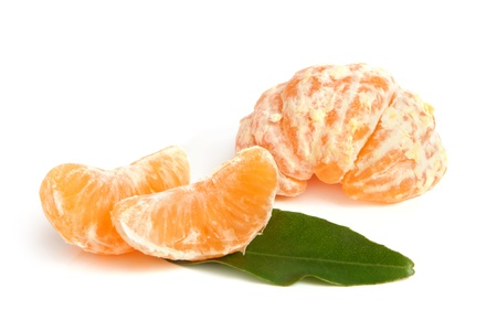 Slices of peeled tangerine on a white background photo