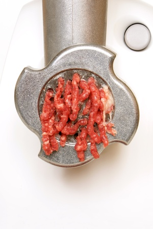 Meat grinder in action, a vertical picture Stock Photo - 8861449
