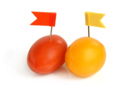 Cherry tomatoes with small flags on a white background photo