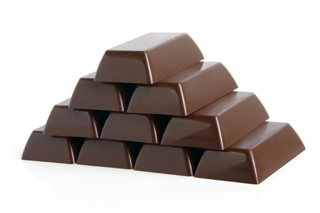 Pyramid of chocolate sweets on a white background photo
