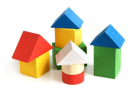 yellow block: House made from childrens wooden building blocks on a white background Stock Photo