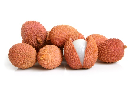 Fresh lychees on the white background photo
