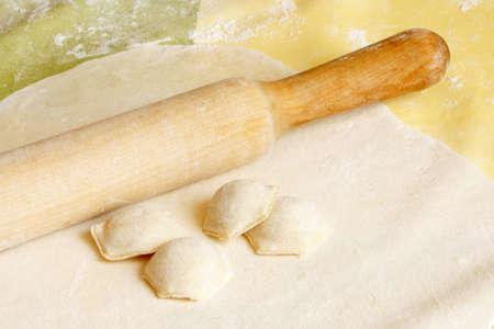 russian food: Making meat dumplings. Traditional russian food.